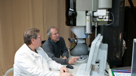 Two Professors looking at the scan from a Electron Microscope