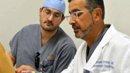 UVA Anesthesiology attending instructing a resident.