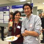Picture of UVA student researchers taking in the poster submissions at UVA symposium.