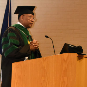 Dean speaking at graduation