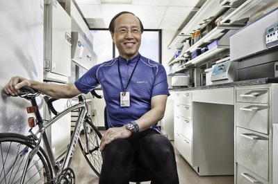 Photo of Professor Zhen Yan with a bicycle