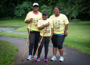 three women in C'ville Walks Shirts
