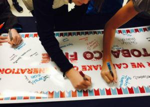 hands signing banner