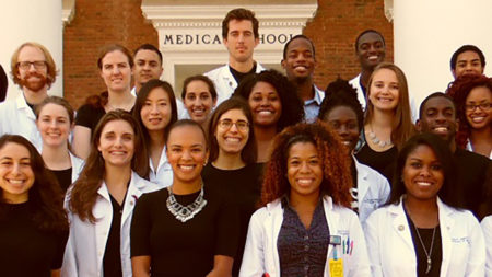 University of Virginia Medical Students gather in front of the old Medical School doorway