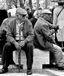 Photo of elderly men sitting on a bench