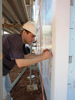 Photo of a worker in a Habitat house