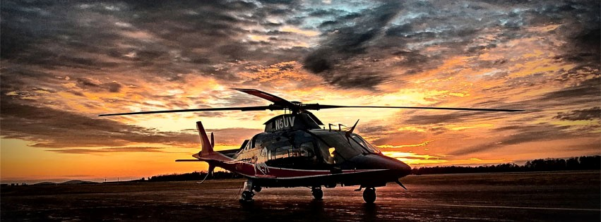 Pegasus, UVA Health's helicopter, parked in front of a sunset
