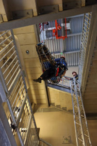 a group practicing a rescue drill in a stairwell
