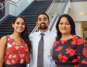 portrait of Malav Patel in dress shirt and tie alongside two family members