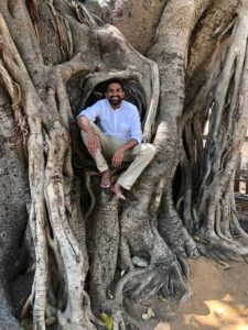 portrait of Abhijit Srungavarapu in a tree