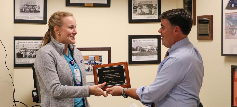 Doctor Sochor hands award to Mary Bacon MD