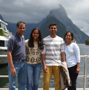 Portrait of Mayur Vallabhaneni with family members by the water with a mountain in the background