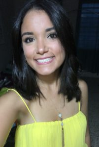 portrait of Ana Romero Vazquez in a yellow top