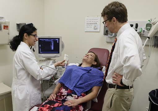 Fellow Ramya Srinivasan practices thyroid ultrasound; Christopher McCartney, MD, Endocrinology fellowship director, looks on.