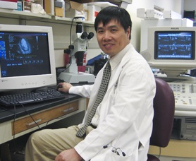 Dr. Liu working in a lab