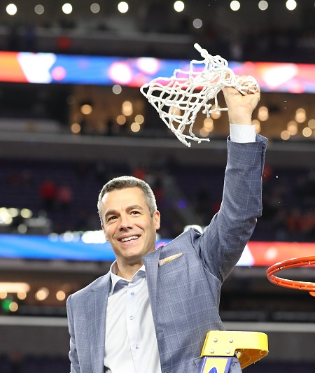 UVA Basketball Coach, Tony Bennett, cutting down the net after winning the NCAA Championship against Louisville! 450x533
