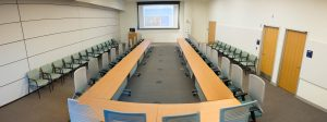 Photo: Education Resource Center Room B at UVA Health. Boardroom set up with single projection screen.
