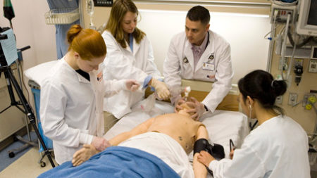 Group of residents and students in the Simulation Center