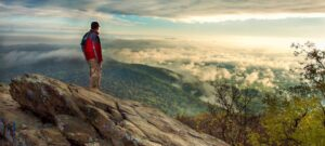 Photo of hiker on mountain top
