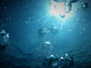 Sun shining through blue water
