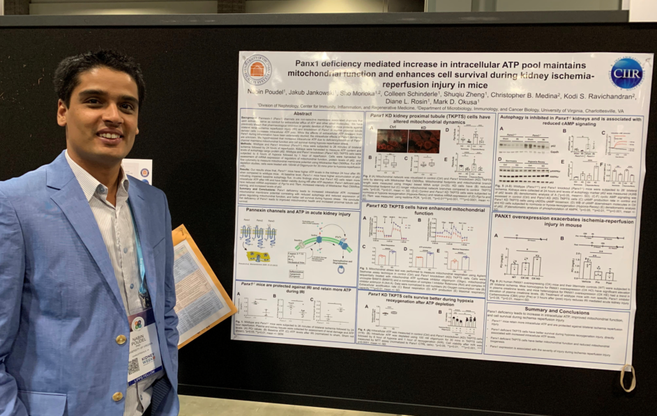 Researcher with poster