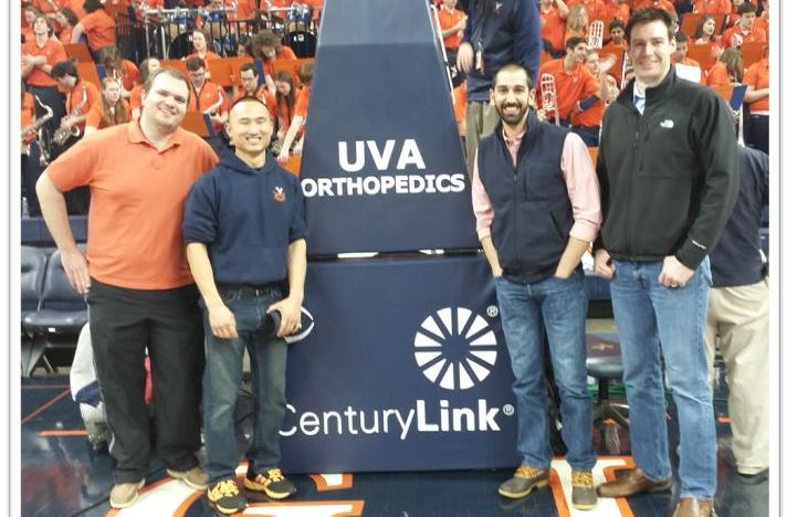 OITE champs on the floor at the UVA basketball game.
