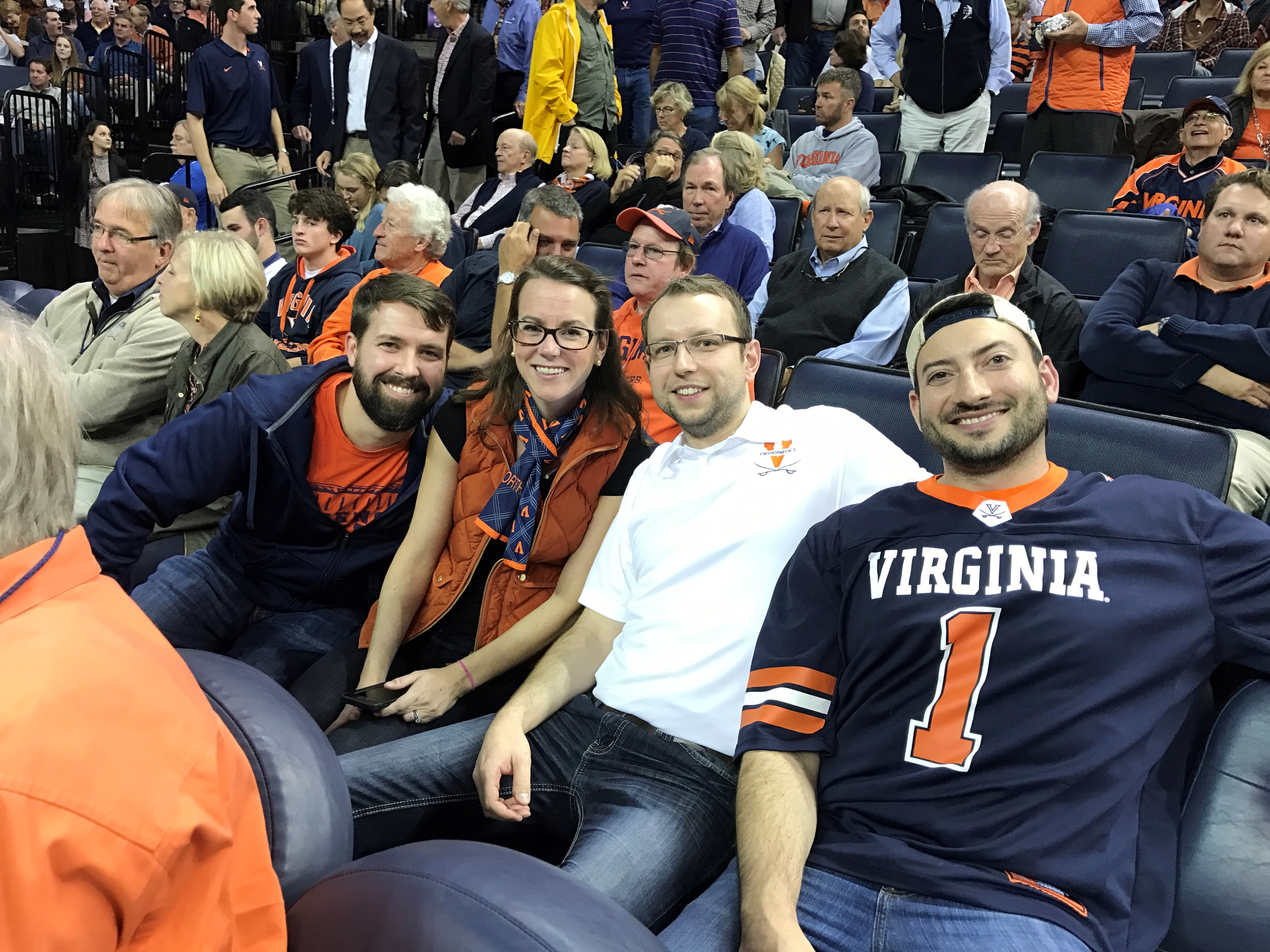 Wojciech Czoch and Mike Hadeed at a UVA Basketball game with Ann and Keith Bachmann.