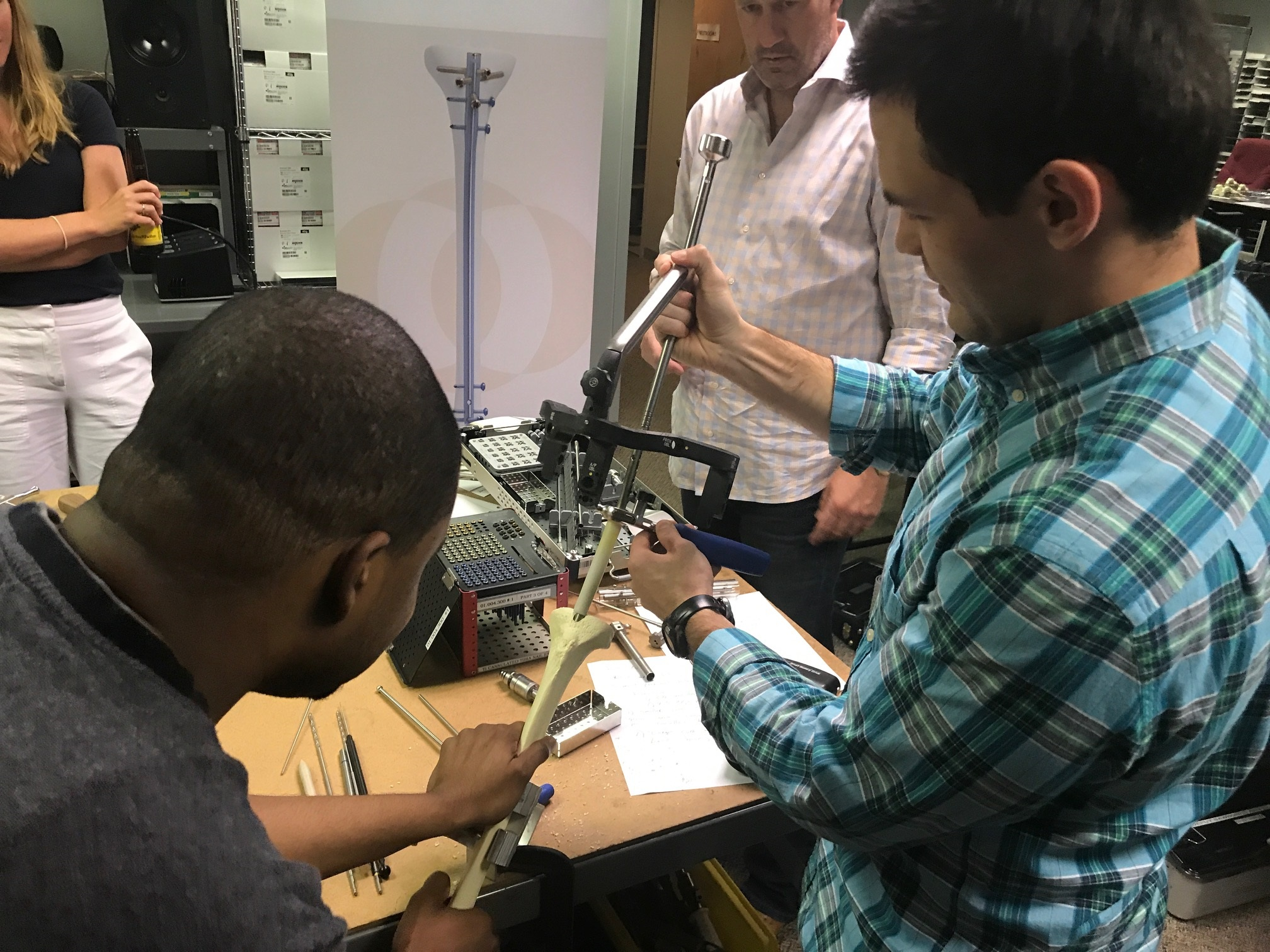 Kevin Laroche assists Aaron Casp during a tibial nail sawbones lab