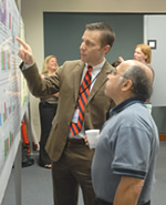 Photo of Professors examining whiteboard