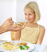 photo of child eating