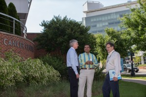 Conaway, Balkrishnan, and Anderson standing and talking outside UVA