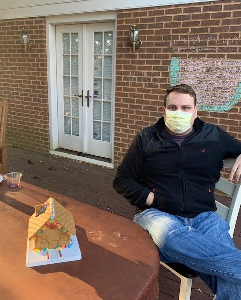 Resident Chris building a gingerbread house
