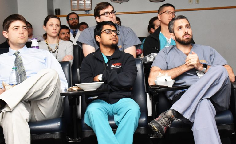 Radiology residents in daily case conference