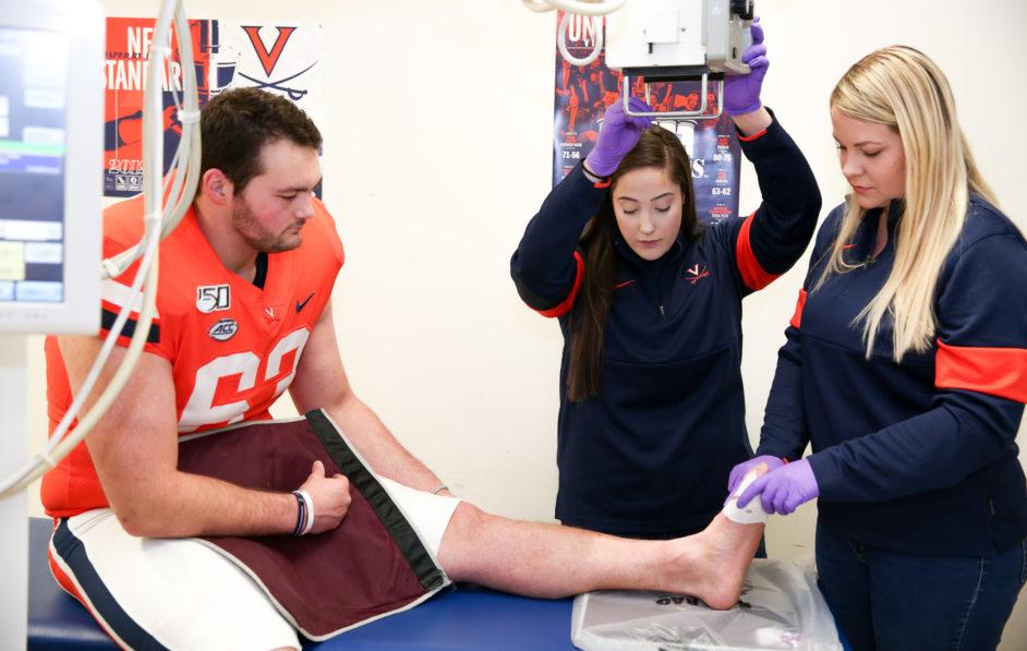 UVA Diagnostic Radiologic Technologists Samantha Shoemaker and Taylor Burton image UVA football players during all home football games