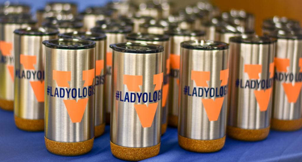 travel mugs with the UVA Radiology #Ladyologist logo on them