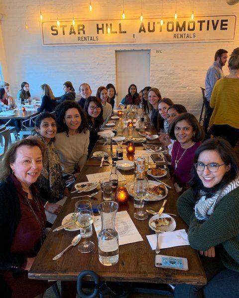 Female UVA students at dinner