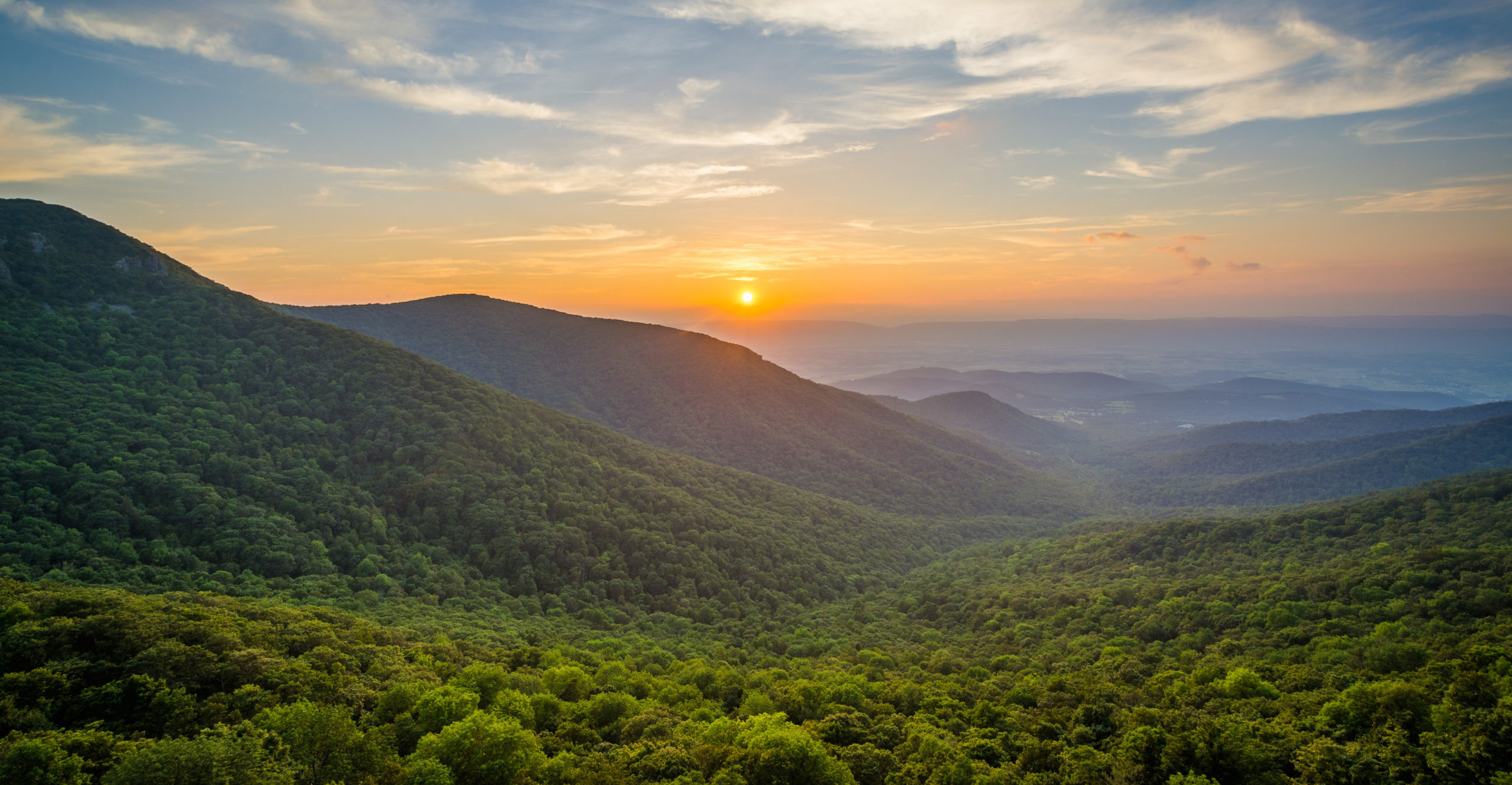 Image of sunset over Shenandoah National Park, located just east of Charlottesville