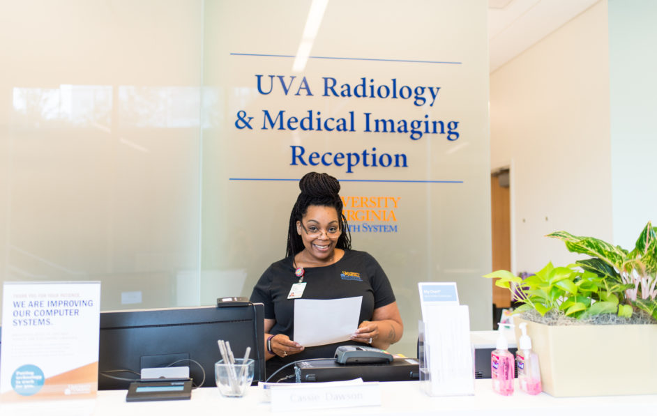 A Radiology Access Associate at the front desk of the Radiology Imaging Center located in the Educational Resource Center