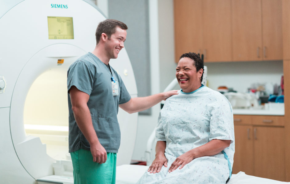 A UVA Radiology technologist comforts a patient after a CT scan