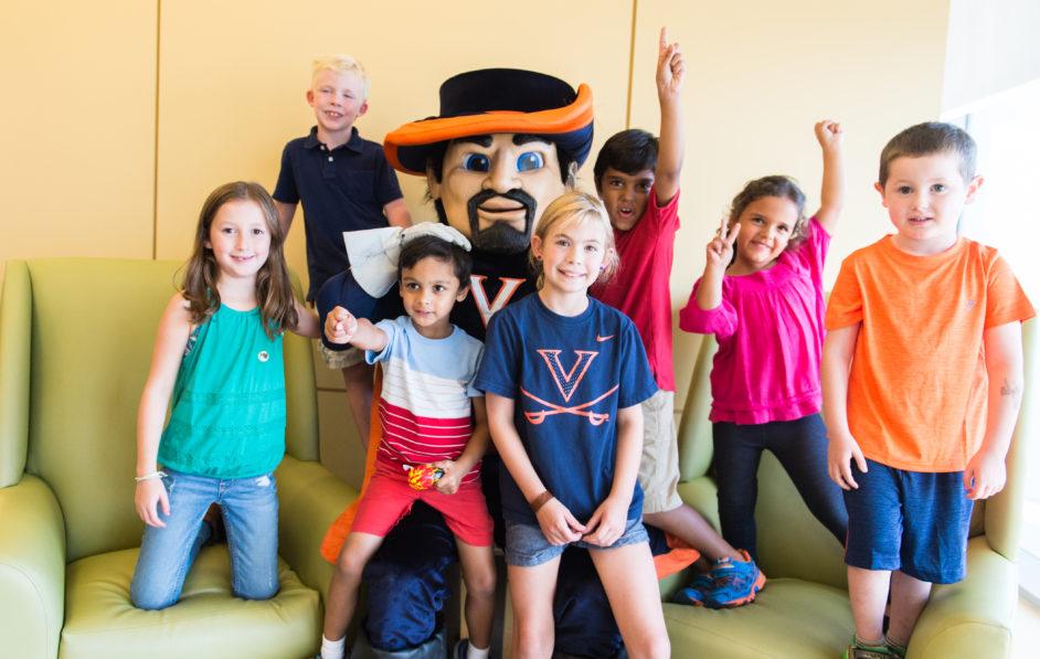 Cav Man, the UVA mascot, poses with patients at UVA Pediatric Imaging
