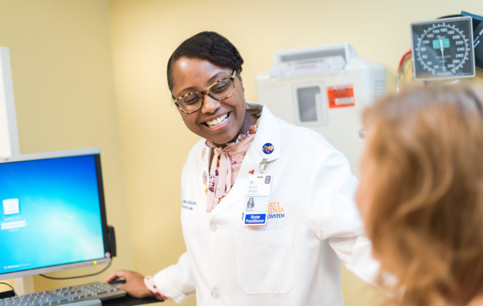 A Radiology nurse practitioner talks with a patient before a procedure