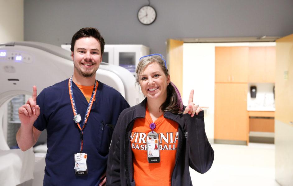 Two Radiology technologists celebrate the UVA Basketball teams 2019 NCAA Championship