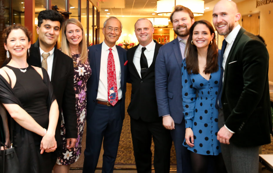 Department Chair Dr. Alan Matsumoto (center, red tie) stands with Dr. Carrie Rochman, left, and Dr. Drew Lambert, right, along with Radiology residents at the 2019 Department Holiday Party