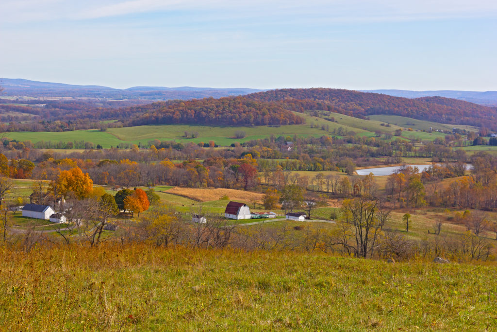 A view on historic site of Sky Meadow State Park in fall, Virginia, USA. Autumn spectacular panorama from a high park vista.
