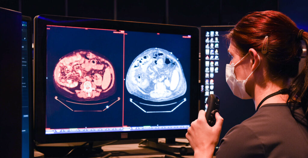 UVA Radiology resident reads images at a workstation