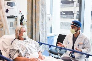 UVA Interventional Radiology Resident Yasser El-Abd talks with a patient