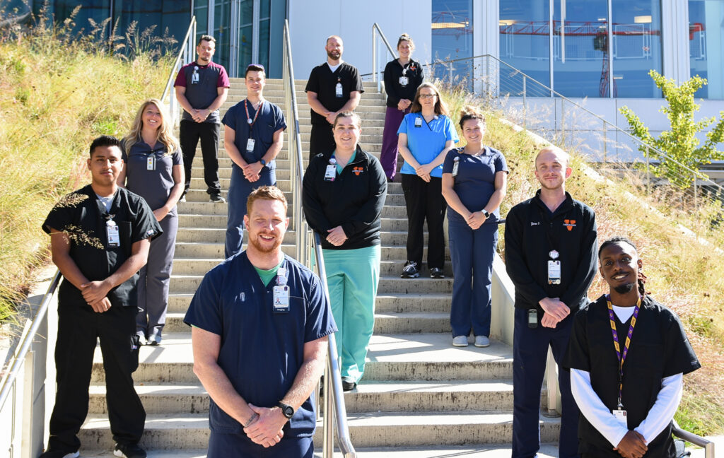 UVA Radiology CT team poses in front of the Education Resource Center (ERC)