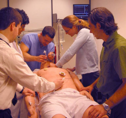 Photo of students practicing the medical management of many toxicological conditions using the human patient simulator.