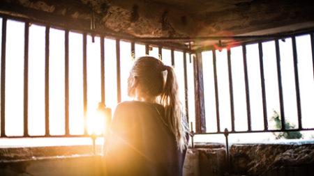 Photo of woman admiring sunrise