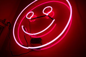 neon smiley face sign